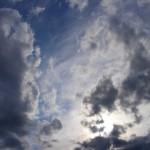 blue sky dark clouds